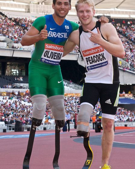 Jonnie Peacock and Alan Oliveira after the Men's T43/44 100m at the Sainsbury's Anniversary Games. P