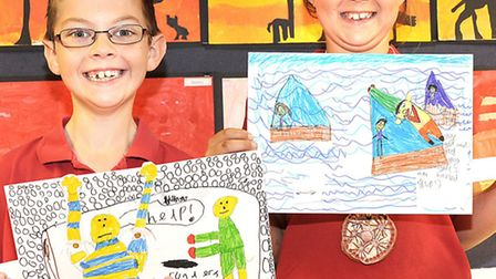 Burrowmoor Primary School, March. Art exhibition, Carson and Olivia show off their moving pictures.