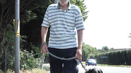 Man unhappy about Wisbech cycle path on Cromwell Road, Wisbech. James MacDonald with his dog Toby.