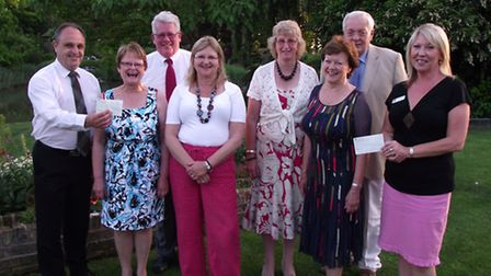 The fundraising committee presenting the cheques to Karen Newton and Jo Newton