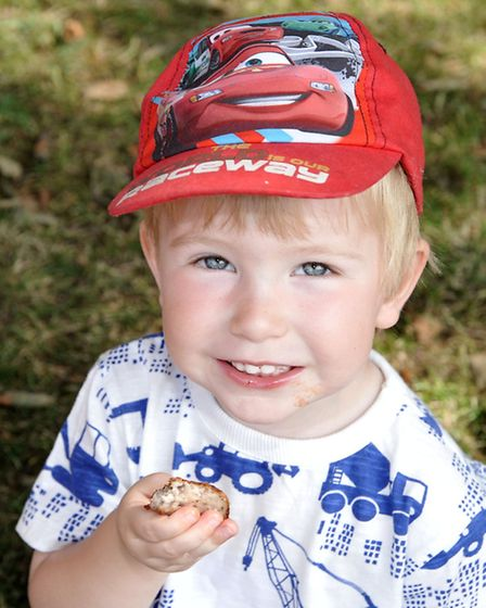 Bacon buttie festival, St Peter's Church, March. Isaac Clark age 3 enjoy's a sausage buttie.