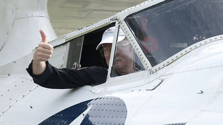 Jeff Boyling, the pilot of the Catalina, gives the thumbs up for take-off.