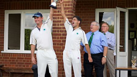 Andy Race and Chris Farnell raise the Lower Junior Cup aloft 25 yearsafter Littleport Town Cricket C