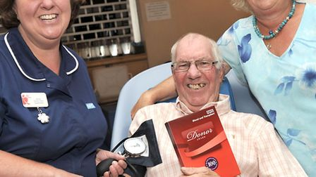 100 pints of blood from Wisbech donor Geoffrey Spencer. Left: Jenny Howlett Donor care supervisor, G