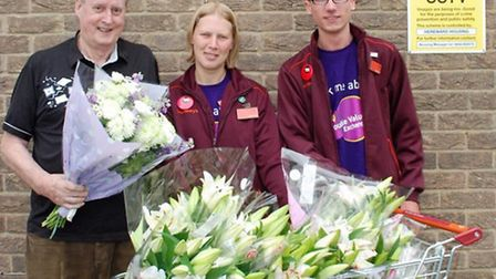left to right- Bell Holt resident Graham McNeil, with Sainsbury's colleagues Stella Churchman and Lu