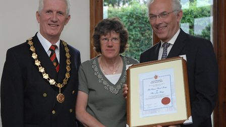 David and Jay Ainge collect their award from Dunmow mayor Phil Milne (left).