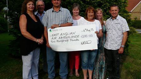 Chairman Kevin Keil presenting the cheque to Mary Dunn from the East Anglian Air Ambulance, together