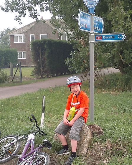 Xander taking a breather during his cycle ride.