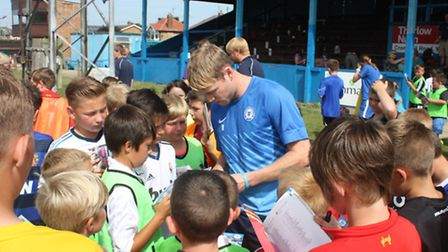Grant McCann is swamped by young footballers at the GER
