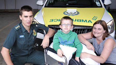 Five year old Zac Colwell meets ambulance crew. March. Left: Ollie Barker paramedic, Zac Colwell and
