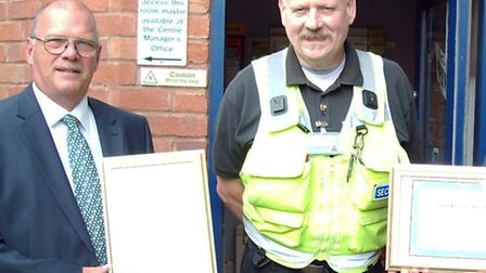 Roger Vanhinsbergh receives a certificate from Gary Clarke, managing director of City City Security