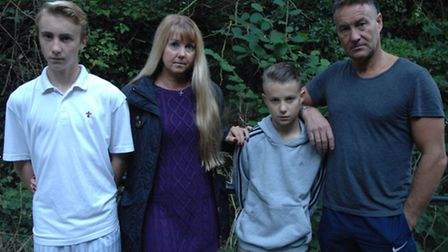 Ollie Bell (centre) with his brother Charlie, mum Tracy and dad Howard