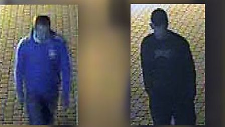 Police have issued a CCTV image of two men they want to speak to following the robbery of a taxi dri