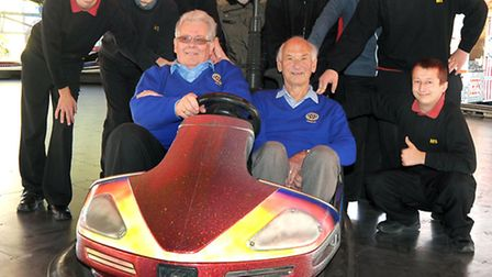 Students from the Meadowgate school, Wisbech. On the Dodgem cars with John Martin President, and Mik