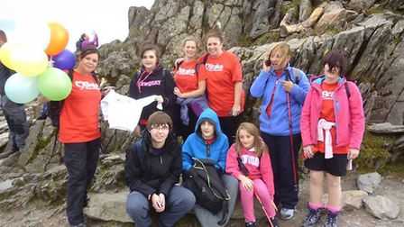 The group at the summit of Mount Snowdon.Back Row - Left to right: Sara, Sara's daughter Sharna, Emm
