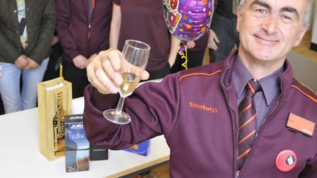 Retiring Paul Dixon has been with Sainsbury's for 41 years , with some of his colleagues at the Ely