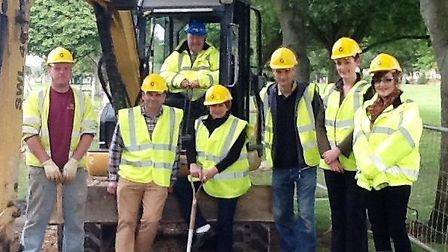 Cllr Peter Murphy tries his hands on the wheels as work starts on £60,000 footpath improvements to w