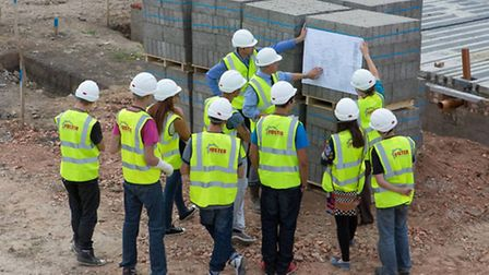 Young people are given a tour of Foster's Parson Drove building site.