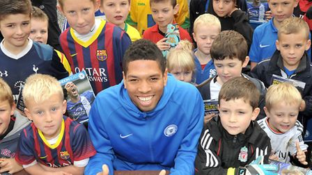 Posh player Nathaniel Knight-Percival. Signing autographs.
