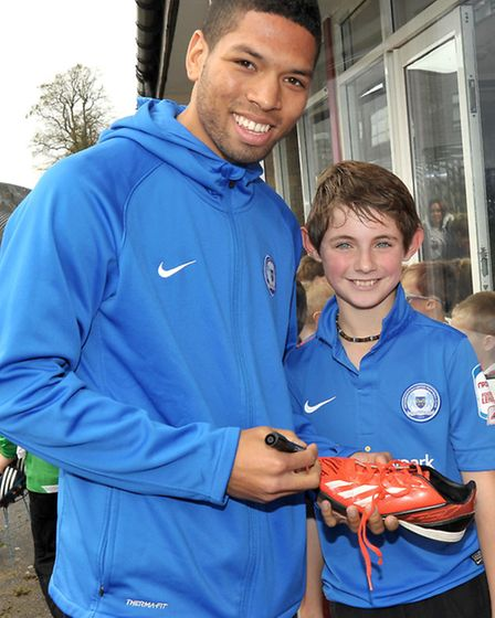 Posh player Nathaniel Knight-Percival. Signing autographs. Ozzy Lovick-lane has his boots signed.