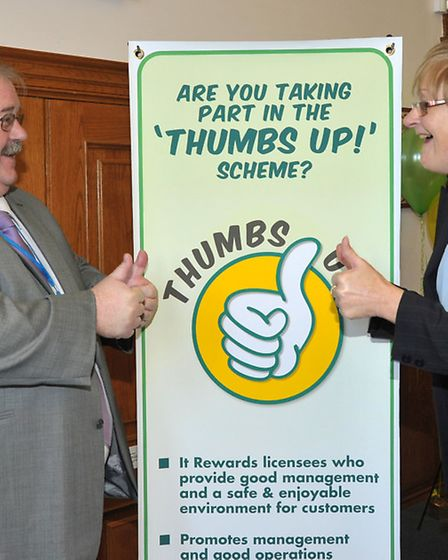 Thumbs Up presentations at FDC council chamber March. Thumbs up for Cllr David Oliver and Cllr Kay M