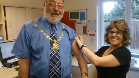 Mayor of Whittlesey, Councillor David Mason, with Dr Parnell at the clinic.