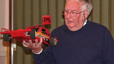 Mike Chilvers demonstrating his model cars.