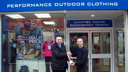 Horsefair manager Kevin Smith, left, presents Trespass store manager Robert Boughen with a bottle of