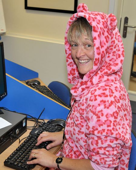 Think Pink Charity Day at Mepal & Witcham Primary School. Head Nicola Jones in her Onsie.