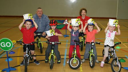 Cllr Pop Jolley and Sarah White with some of the young bikers.