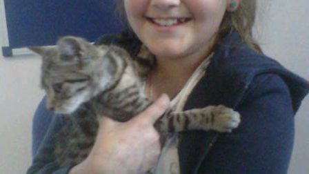 Imogen Searle and her timid cat Bagsy, who inspired the Calm Cats Clinic