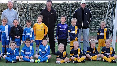 March Soccer School youngsters were kindly presented with new kits by Garry Mills, Managing Director