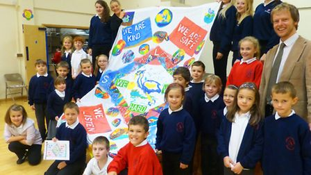 Littleport and Ely pupils unveil the new school flag