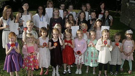 The young dancers show off their certificates.