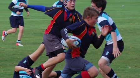 James Fear makes a break against King's Ely in a match which the under-14s won 36-20. Picture: MIK
