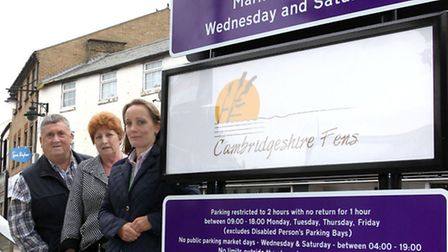 New sign at March Market place. Left: Cllr Pop Jolly, Cllr Jan French and Vicki Whittingstall Econom