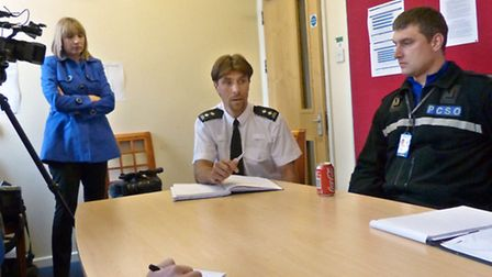 Insp Robin Sissons, centre, briefs officers and the media before a recent Operation Pheasant investi