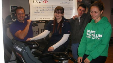 Uniformed services tutor Adi Kent and James Elsey hold the cheque while Amy-Louise Thompson and MacM