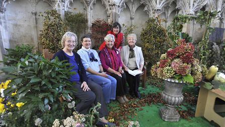 Ely Cathedral Harvest Festival preperations, Flower Guild Members (l-r) Marie Twin, Grace Bent, Ann