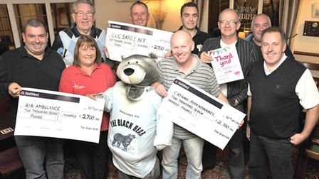 Presentation to £8000 to three local charities at the Black bear at Wisbech. left: Joe hill landlor