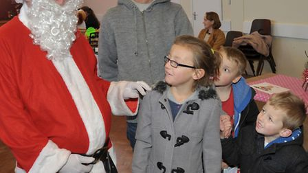 Christmas bazaar at the Queen Mary Centre Wisbech. The Quartly Family meets Santa.