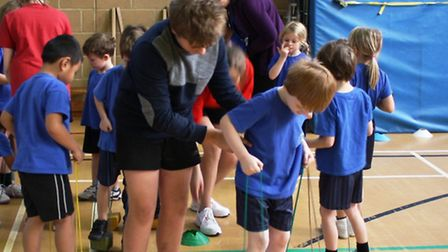 Youngsters practice their circus skills
