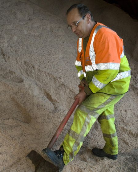 Steve Flack, 54, digs into the huge pile of grit inside the Witchford dome
