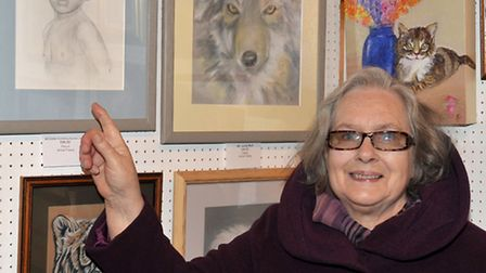 Wisbech Art Club winter exhibition at St Peters Church, Wisbech. Ann Feary with a pencil drawing of