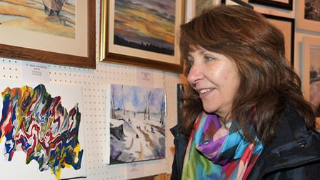Wisbech Art Club winter exhibition at St Peters Church, Wisbech. Sharon Judd looking at the artworks