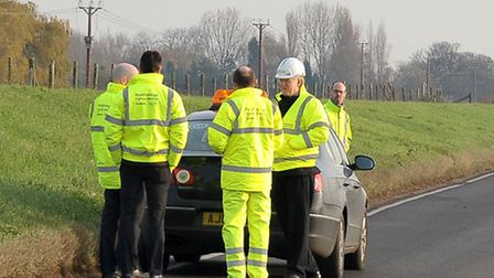 North Bank Whittlesey.Highways Engineers ready to inspect the road.