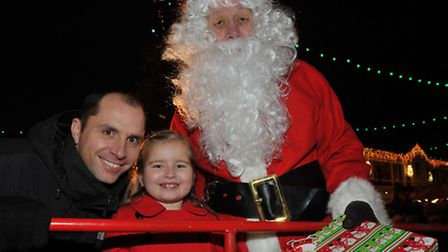 Chatteris Christmas Lights switch on 2013. Joe Perry, Lexie Perry and Santa. Picture: Steve Williams