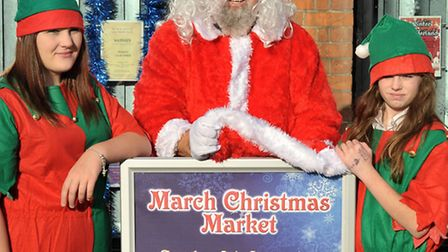 Santa, elves and carol singers in market square, March. Santa's helpers, Left: Shannon Fance and Bri
