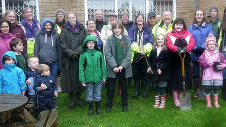Parents, children, Street Pride volunteers and council workers banded together to plant some new tre