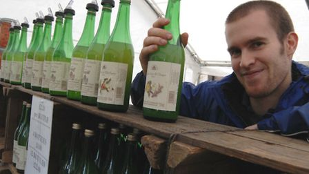 James Fisher from Watergull Orchards, Wisbech, selling apple juice at Ely Apple Festival.